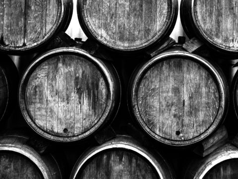 Stacked Wine barrels at the german winery. Wine casks at the winery.